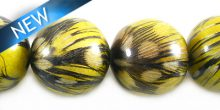Round nangka bead embedded with guinea feather