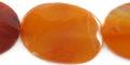 Carnelian wavy flat oval wholesale gemstones